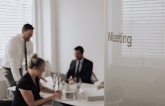 The lawyers of the law firm Jansen & Jansen in a meeting room